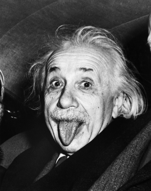 14 Mar 1951, Princeton, New Jersey, USA --- Albert Einstein sticks out his tongue when asked by photographers to smile on the occasion of his 72nd birthday on March 14, 1951. --- Image by © Bettmann/CORBIS