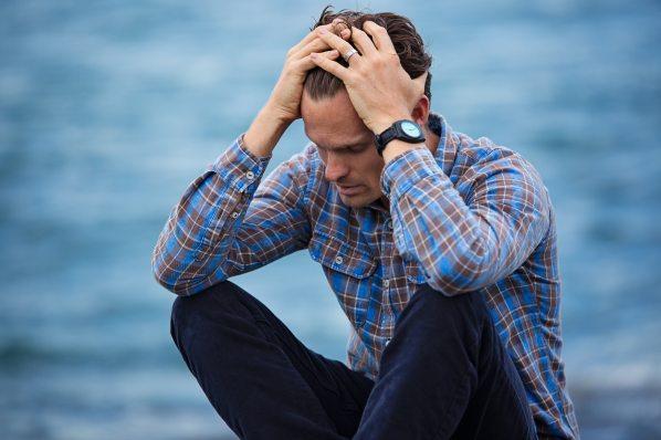 man-in-blue-and-brown-plaid-dress-shirt-touching-his-hair-897817.jpg